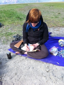 Katie doing artwork on the beach ~ photo by Solveig